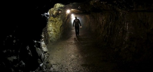 """A man walks through a tunnel, part of the Nazi Germany """"Riese"""" construction project, near an area where a Nazi train is believed to be, in Walim near Walbrzych"""