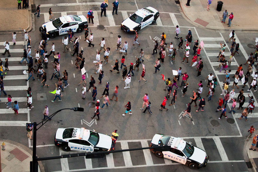 Protesters march during a Black Live Matter rally in downtown Dallas on Thursday, July 7, 2016. Multiple media outlets report that shots were fired later Thursday during the protest over two recent fatal police shootings of black men. (Smiley N. Pool/The Dallas Morning News via AP)